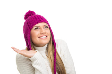 Cute young woman with pink beanie hat looking up