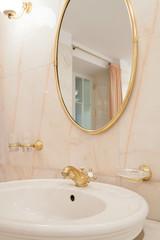 Gold elements in luxury bathroom
