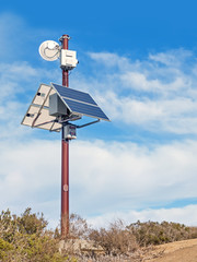 Solar powered surveillance camera monitoring rural area