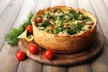Vegetable pie with broccoli, peas, tomatoes and cheese