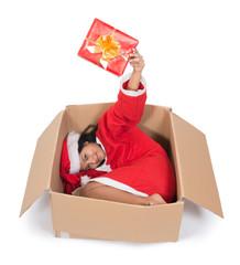 woman in Santa Claus dress lying inside paper box