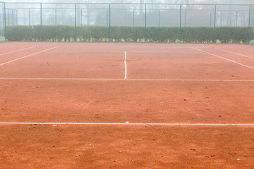 tennis court with fog