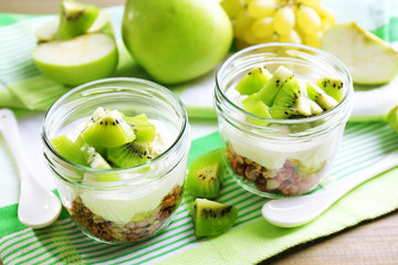 Healthy dessert with muesli and fruits on table