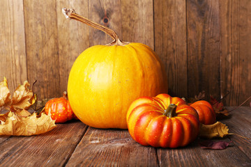 Ripe pumpkin on wooden background