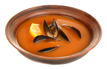 Tasty mussel soup in bowl isolated on white