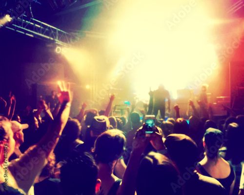 a crowd of people at a concert (focus on the phone photo) - 74115826