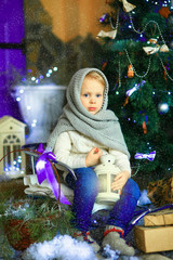 the girl near a Christmas fir-tree 10