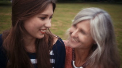 Mother and Daughter embrace in park