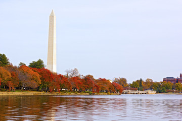 National Monument with trees around the Tidal Basin in autumn