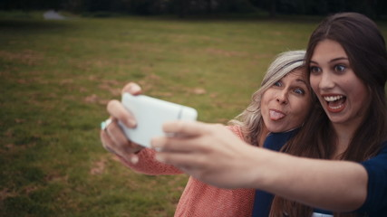 Mother and Daughter Take Selfie Together With Smart phone
