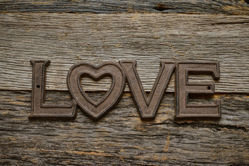 Word Love on rustic wood background