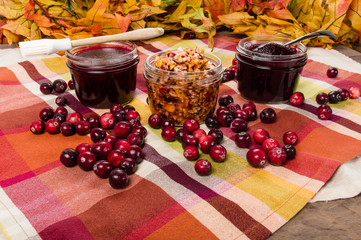 Two jars of cranberry sauce with cranberries