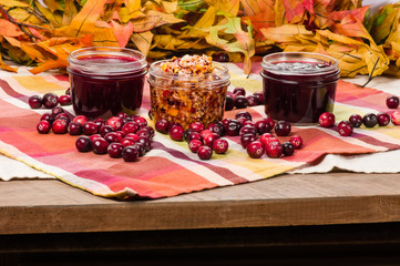 Cranberry sauce with cranberries on wooden table