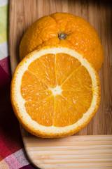Orange cut in half on cutting board