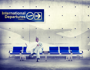 Businessman Reading Flight Terminal Airline Concept