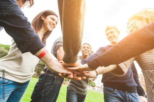 Multiracial Group of Friends with Hands in Stack, Teamwork - 74118640