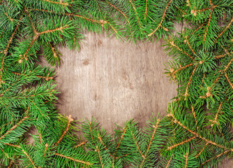 wooden background with space for text with fir branches