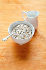 oatmeal in a bowl on wooden boards