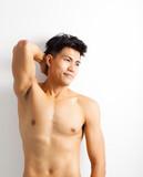 smiling shirtless muscular young asian man
