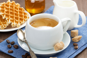 cup of coffee, waffles and honey