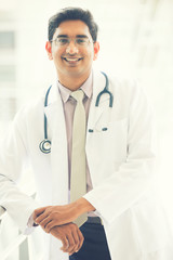 indian male doctor outdoor, slight vintage tone