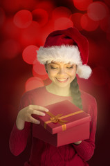 chinese girl opening christmas gift surprise look