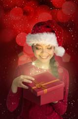 asian girl opening christmas gift