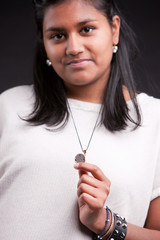 indian girl showing a local coin