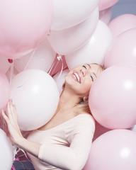 young happy blonde woman with baloons smiling