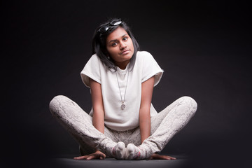 portrait of a crouched indian girl