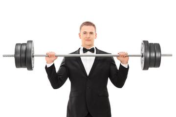 Elegant man holding a heavy weight