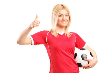 Female football fan giving a thumb up
