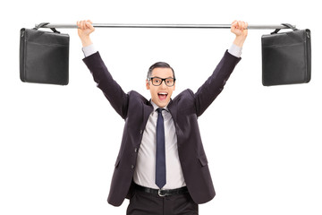 Joyful businessman lifting two briefcases on a bar