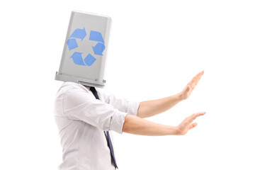 Lost man with a recycle bin over his head