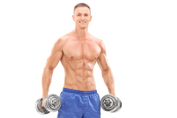 Male bodybuilder holding two barbells
