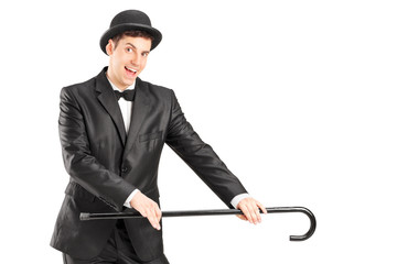 Male magician holding a cane