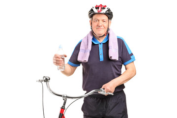 Mature biker holding a water bottle