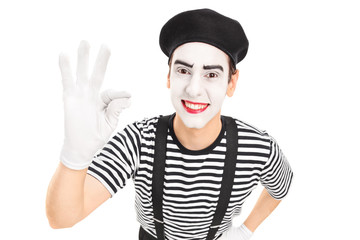 Mime artist gesturing with his hand