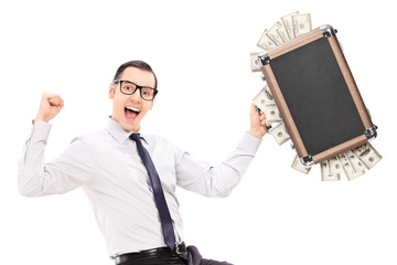 Overjoyed businessman holding a briefcase full of money