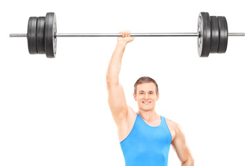 Strong athlete holding a weight in one hand