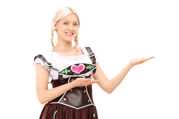 Woman in Bavarian costume gesturing with hands