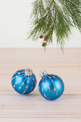 Christmas baubles and pine tree branch