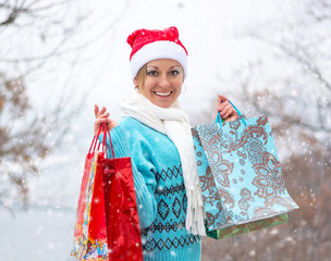 Happy woman with shopping bags before Christmas