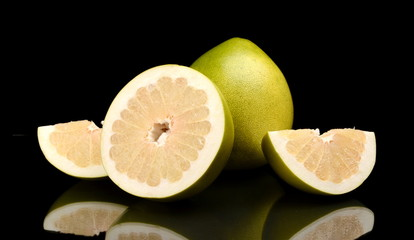 Four pomelos,half,quarter isolated on black