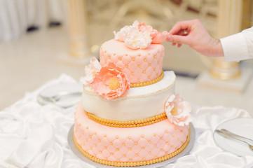 Waiter Touching Cake