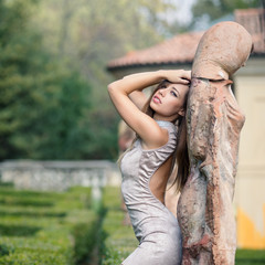 Sensual young woman fashion portrait outdoors in a park.