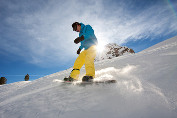 Young man snowboarding