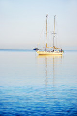 Sailing Yacht in the sea at sunrise