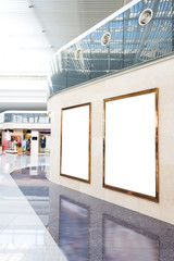 blank poster board wall in modern shopping mall