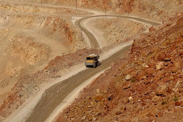 huge trucks work in a quarry mining